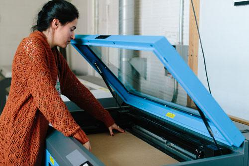 Working on the Plotter, Architecture Lab, Photo by Justine Bursoni